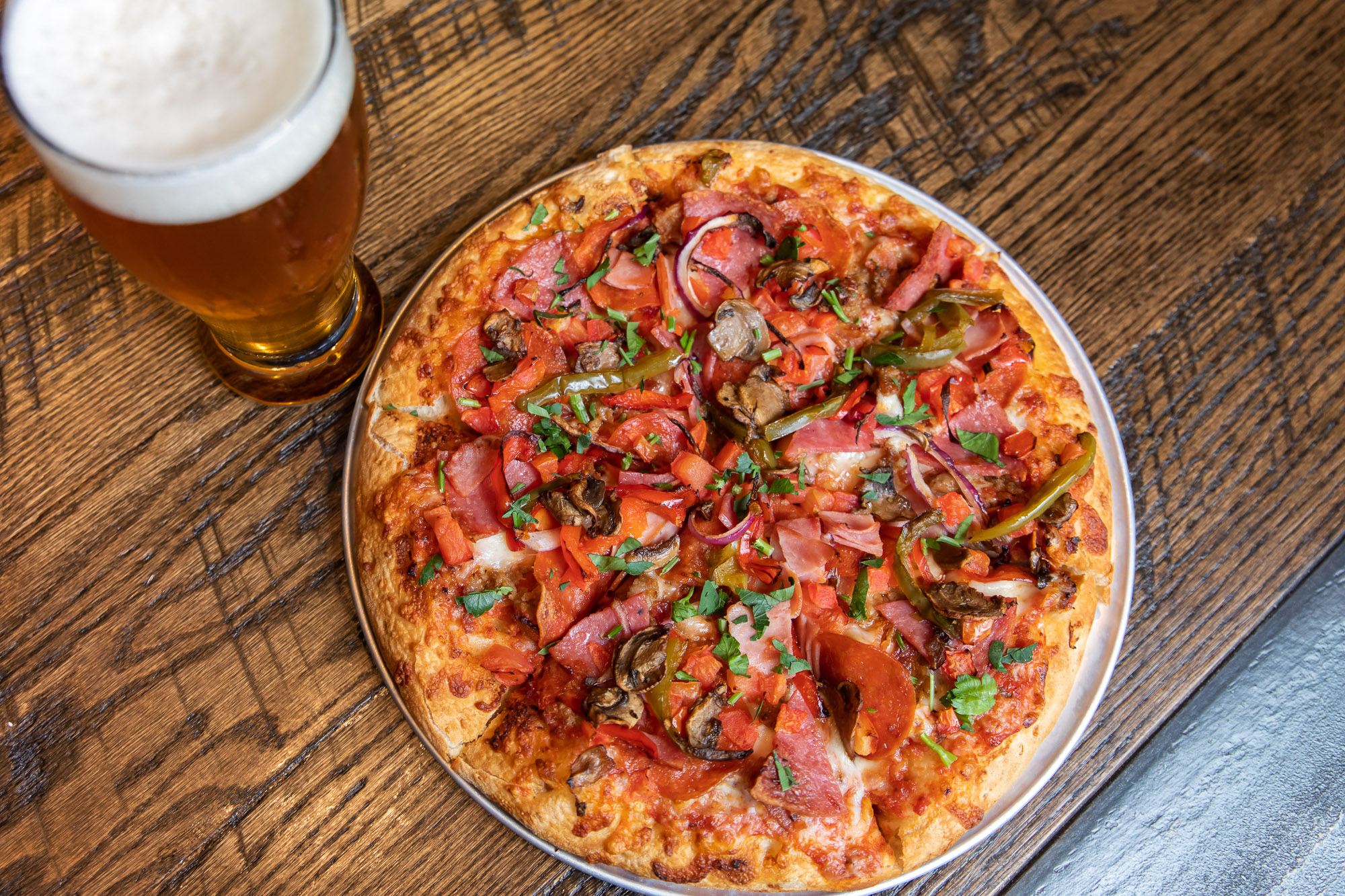 Flix Brewhouse pizza and beer on bar, Studio K10